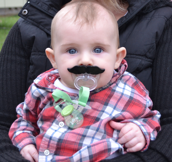 AH, his hair fell out and grew in weird and we made him use a pacifier that looks like a mustache. Six months