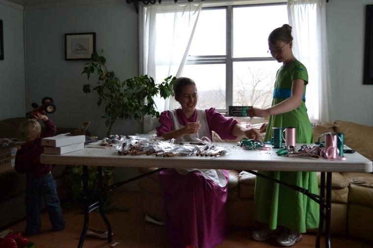 See, just like an Austen novel, us fancy ladies sitting around tying ribbons.