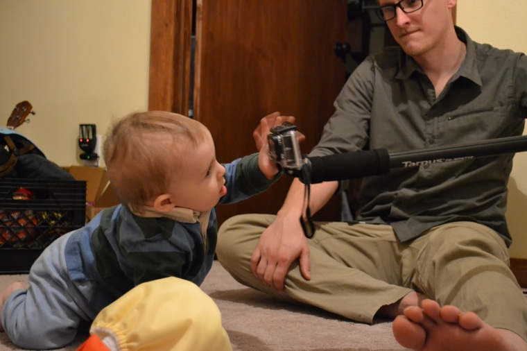 "Dan is recording the baby with his GoPro camera - making sure it's ""monkey proof."""