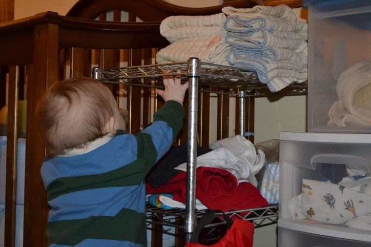 speaking of chaos...this is where baby proceeded to unfold all his cloth diapers and create more work for me...isn't he cute?