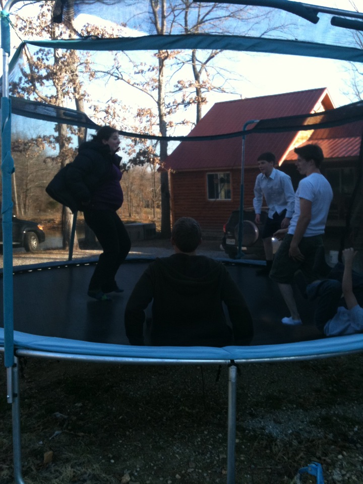 Jumping on the trampoline with my three younger brothers...but not too high. Boy did I get some good laughs in.
