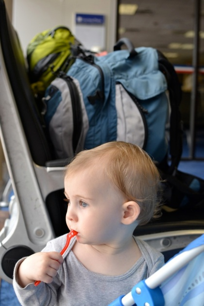 He really enjoyed pushing his stroller all over the DFW airport - I sure the other travelers looooved it.