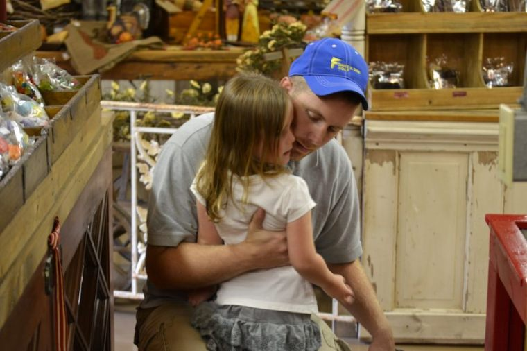 Mike getting some sweet hugs from his baby girl.