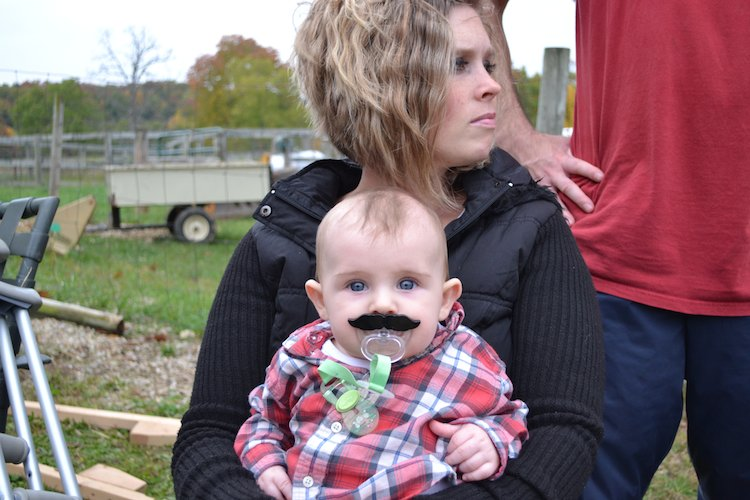 Rebecca holding Wiley - who is rocking the Stache-fier.