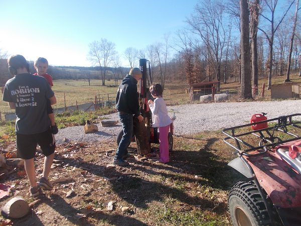 The grandkids love to help with farm chores.