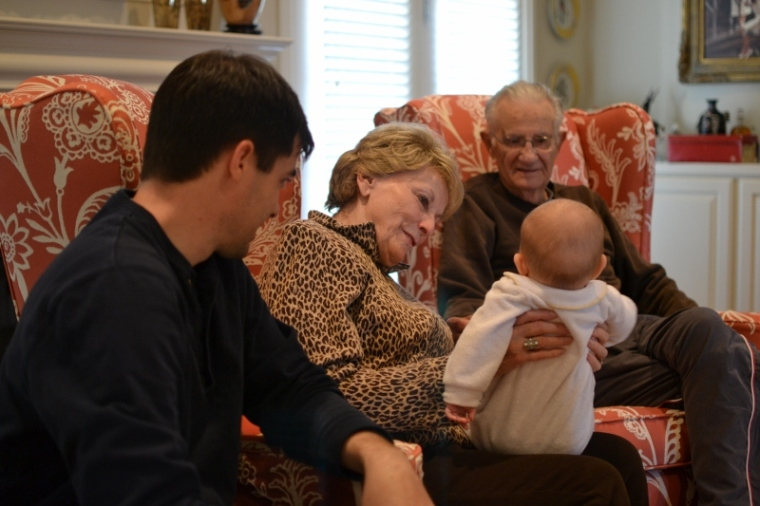 The great-grands holding their youngest great grandchild.