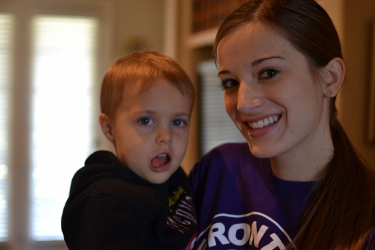 My cousin Mary holding my nephew.