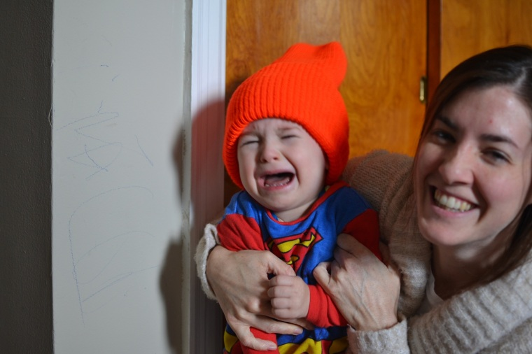 The baby put this orange hat on before the incident...he loves wearing hats.