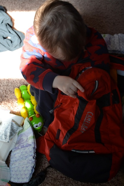 Taking everything out of the diaper bag, for the third time today.