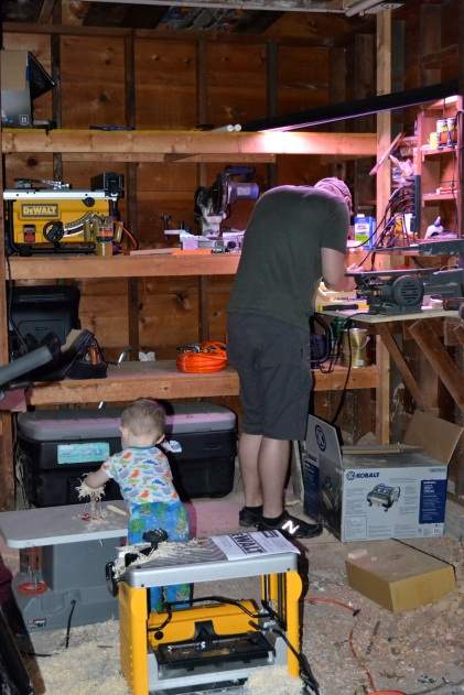 Wiley loves being with his Daddy - Danny is working on a bed frame for our room.