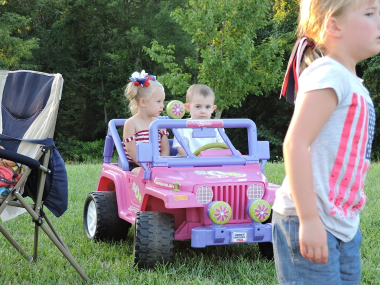 This kid was having the time of his life. But what little guy wouldn't in a Barbie Jeep, with Barbie in the passenger seat?