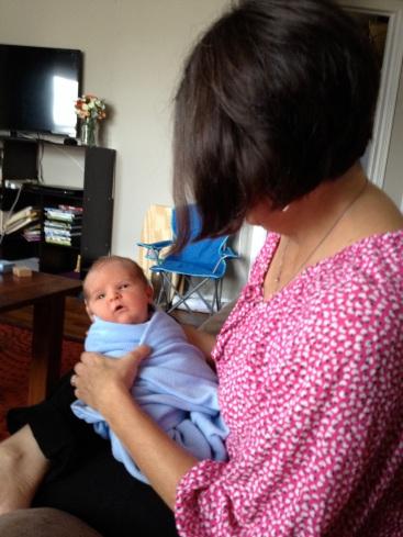 Grandma holding new guy.