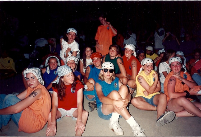 My older sister (the beautiful girl wearing a red shirt with a white bandana on her head in the top/right of center of photo) was sixteen was there and so was my mom (the silly lady on the top left wearing a white shirt flexing her arm), to which I'm sitting right next to my mom, wearing a white shirt with a TIGER face on it - I always marched to the beat of my own fashion drum...