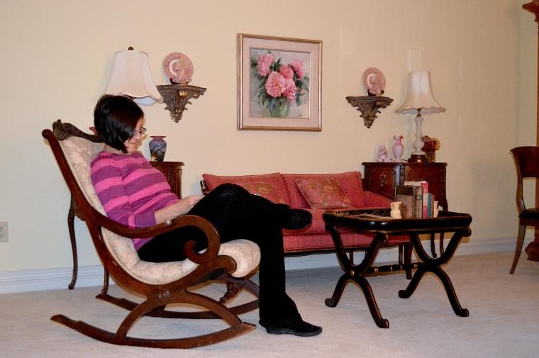 My mom reading in my Gramma's bedroom.