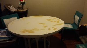 So, after I painted the table, I put wood filler in the craters and sanded it down.