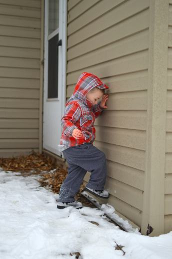 Cleaning the snow from his boots - it's so cute what kids pick up from parents.