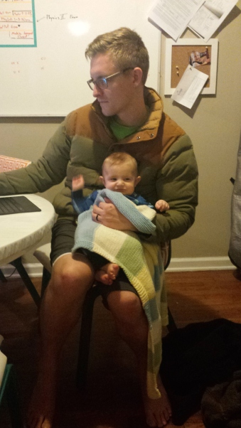 Studying. I just needed help for a few minutes. Generally, Danny doesn't hold babies when he studies.