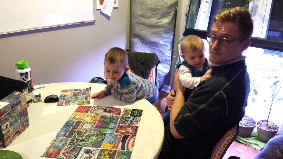 Family night...Danny took one for the team and helped put this puzzle together.