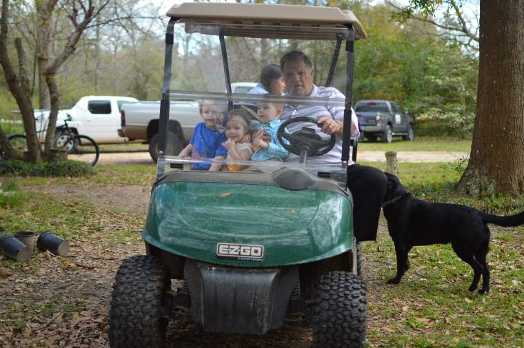 Papa driving the Grands around to look/feed animals.