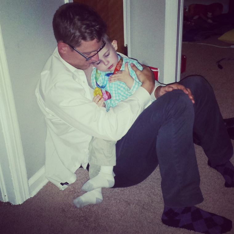 Daddy helps Wiley calm down after a temper tantrum.