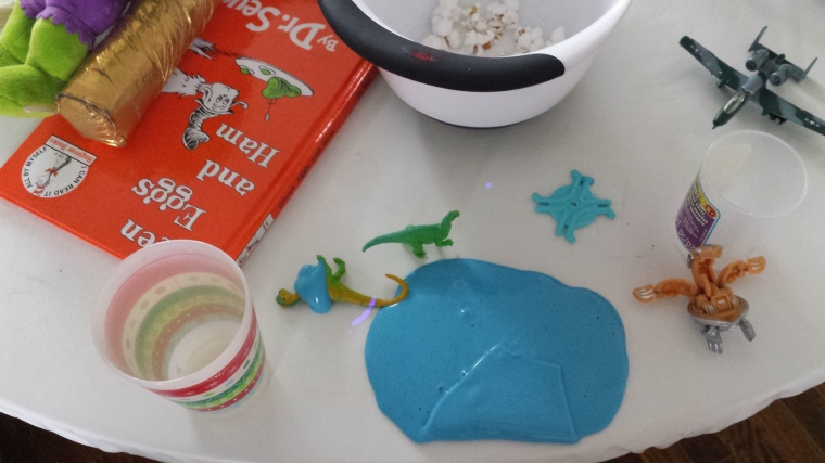 That blue goo is called FLARP - you can find it at Michael's craft store for $1. It will bring your toddler HOURS of entertainment for an entire week. Then you buy more. Mother's Serenity for ONE whole dollar.