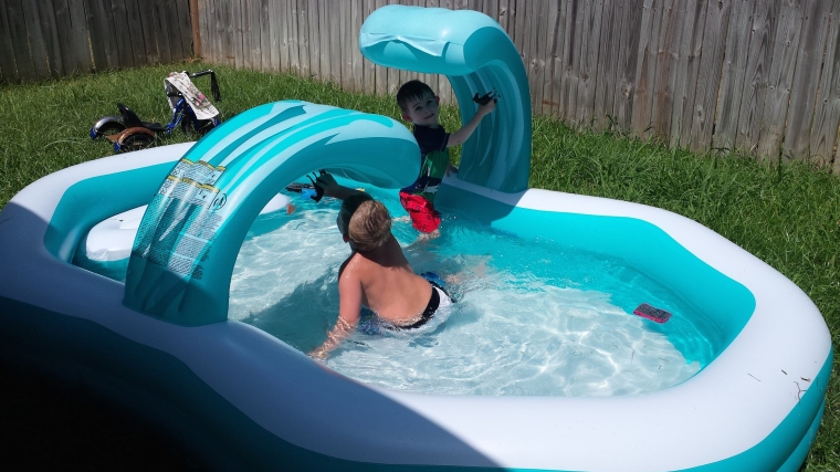 Wiley swimming with his cousin K.