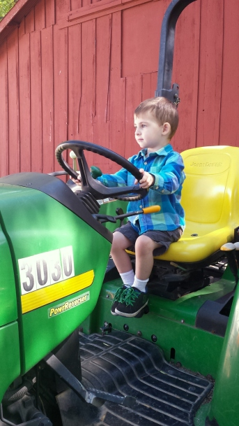 This boy LOVES tractors.