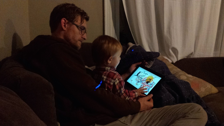 Daddy and Tyler creating art before bed.